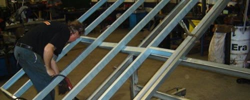 A man working on the steel frame in a warehouse