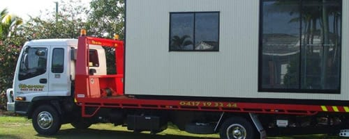 A truck delivering portable apartment or building to the desire destination
